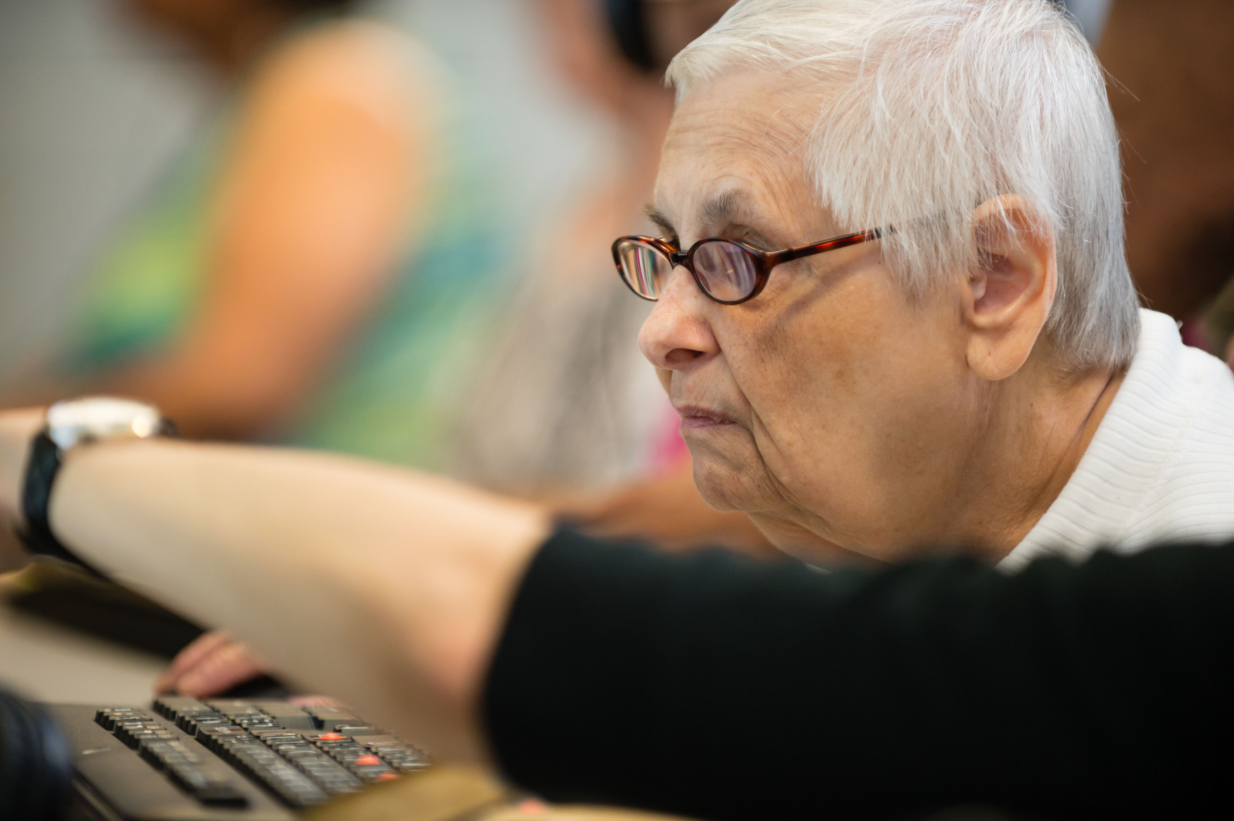 Member of Seniors Program learning computer skills