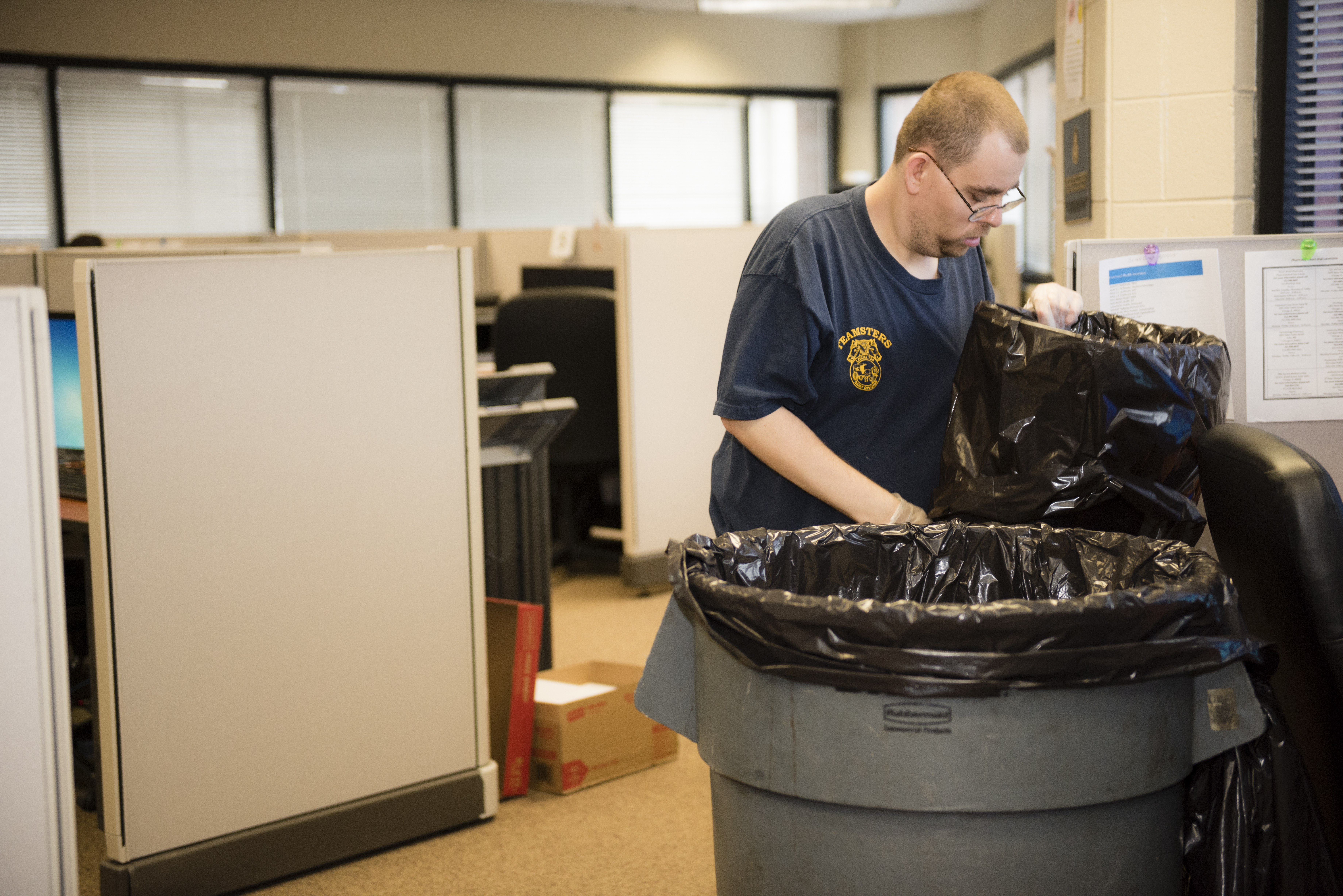 ALS client who also works at the lighthouse empties trash