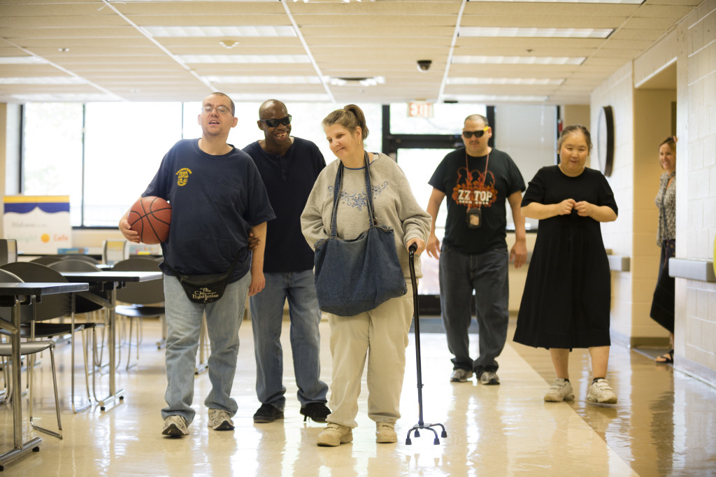 5 adult living skills participants walking