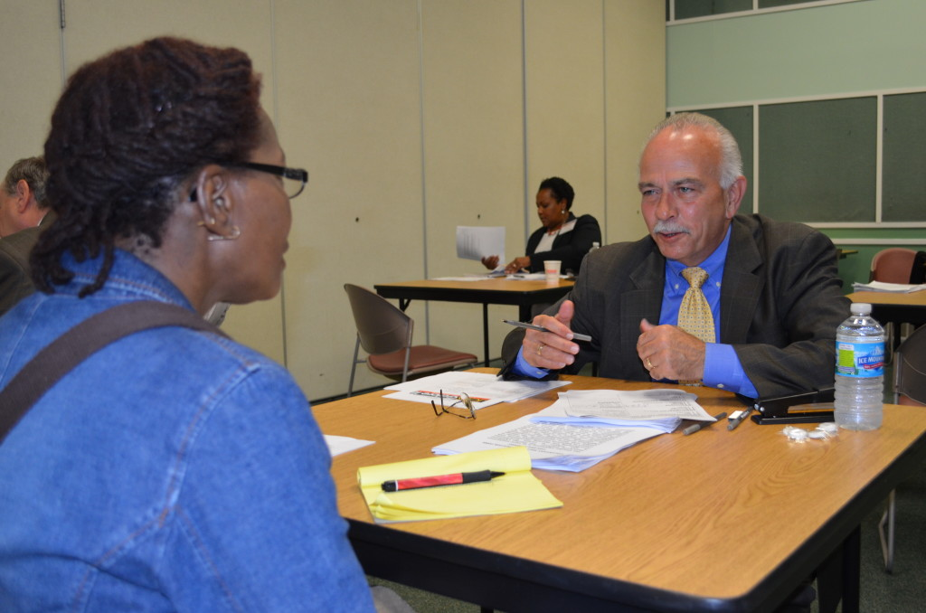 Lighthouse Board Member, Jack Stonebreaker practices interviewing skills with a visually impaired woman