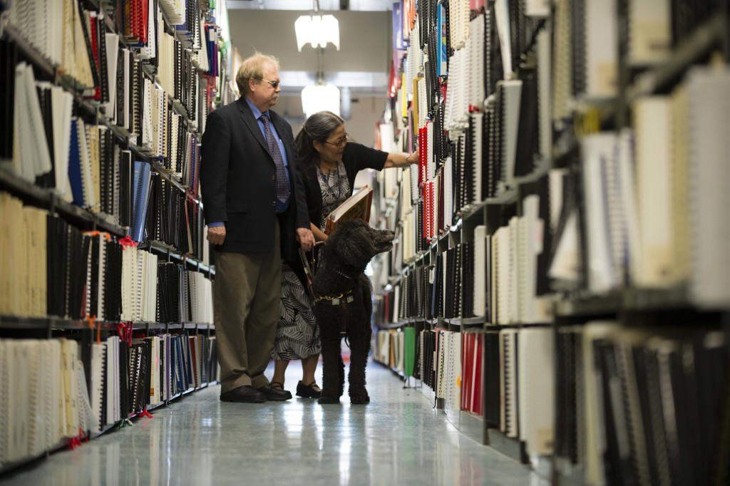 Employees of the IIMC browse the Braille textbook aisles