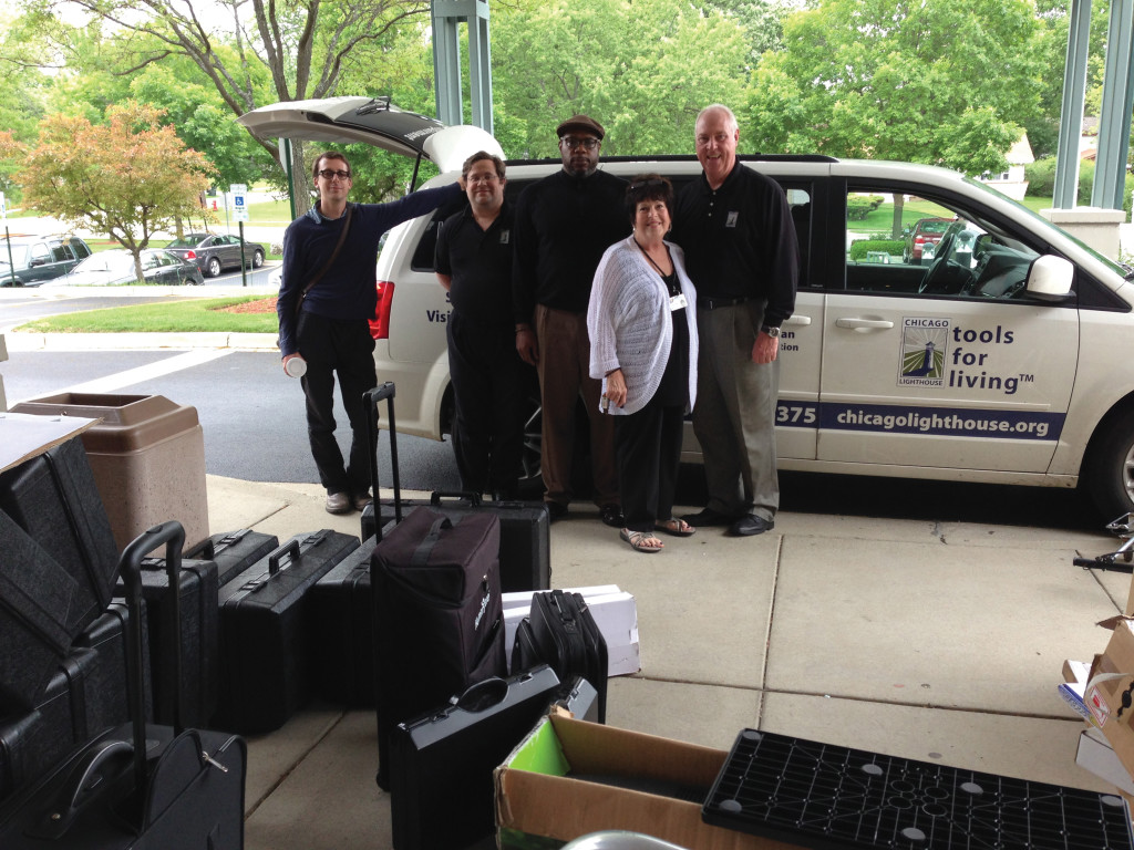 The Assistive Technology Road Show team about to load up the van to demonstrate devices to maximize remaining vision for people with low vision