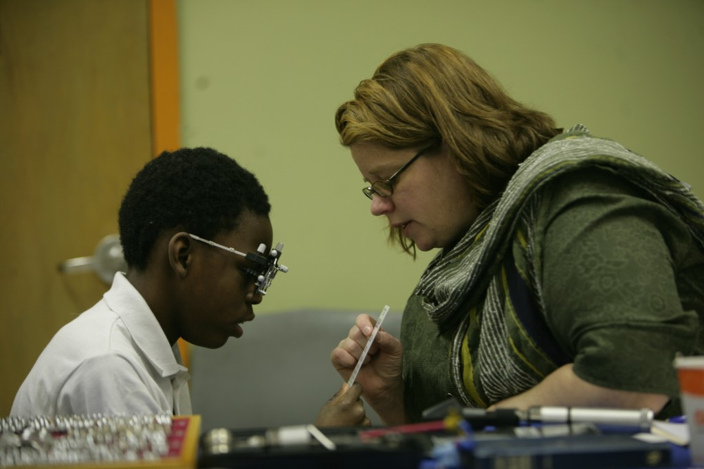 A student is evaluated for glasses by low vision optometrist, Tracy Matchinski
