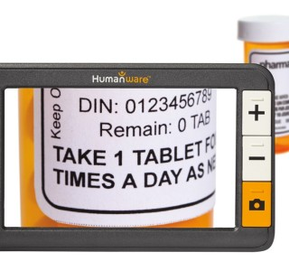 The explore 5 is seen in front of  bottle of pills, which shows magnified on its screen.