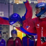 A participant and instructor indoor skydiving