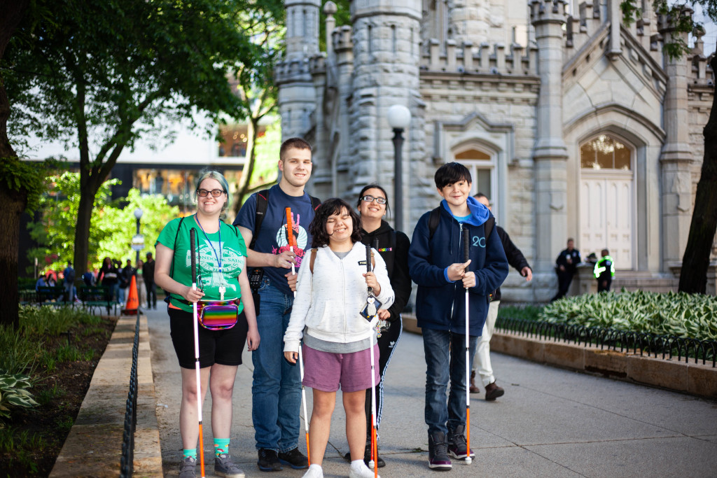 A group of Summer in the City participants stand outside The Chicago Water Tower