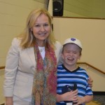 Participant Daniel and Lighthouse CEO Janet Szlyk smile for a photo together