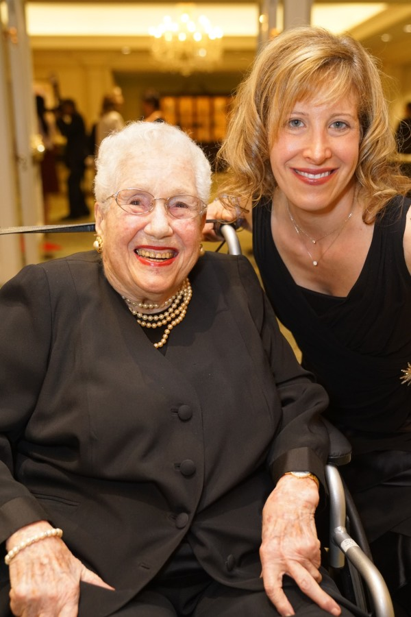 Mrs. Mayer smiles next to Jen Miller during a gala for The Chicago Lighthouse