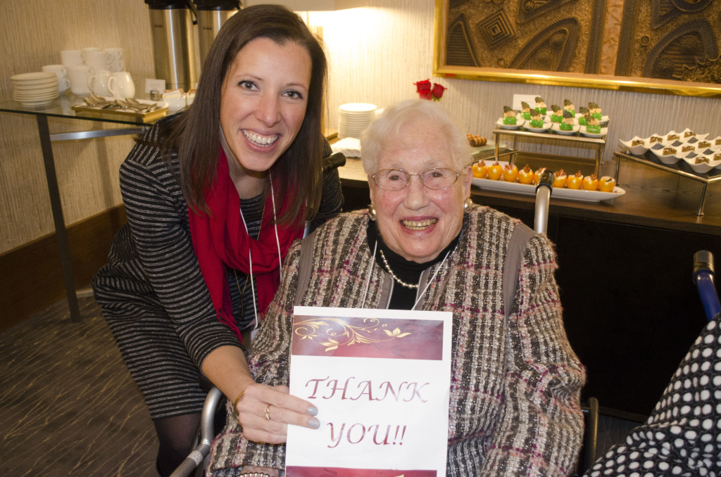 Mrs. Mayer and Laurine O'Donnel holding up a thank you card from the Seniors of The Chicago Lighthouse.
