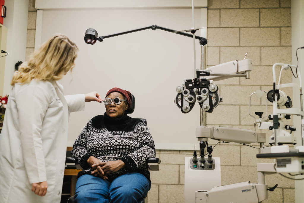A doctor in The Chicago Lighthouse Low Vision Clinic works with a patient.