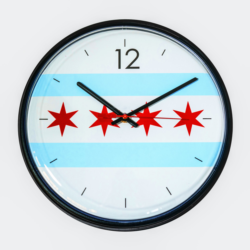 A clock features an image of the Chicago Flag