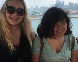 A teenage girl who is blind enjoys the Chicago Lakefront with her counselor