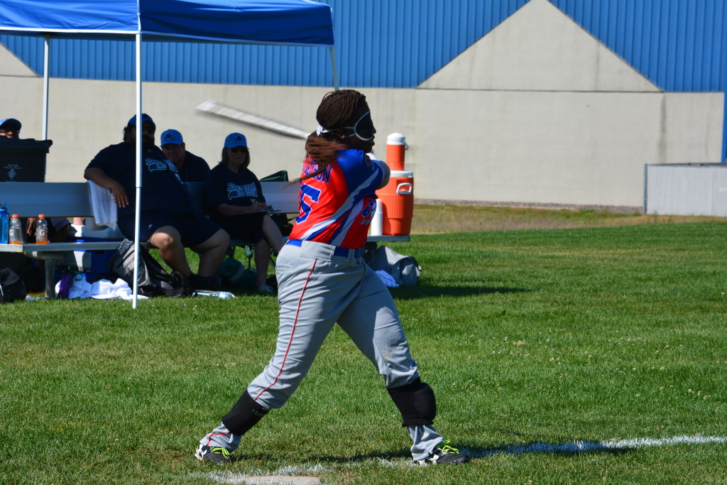 Kalari takes a swing while playing beep ball.
