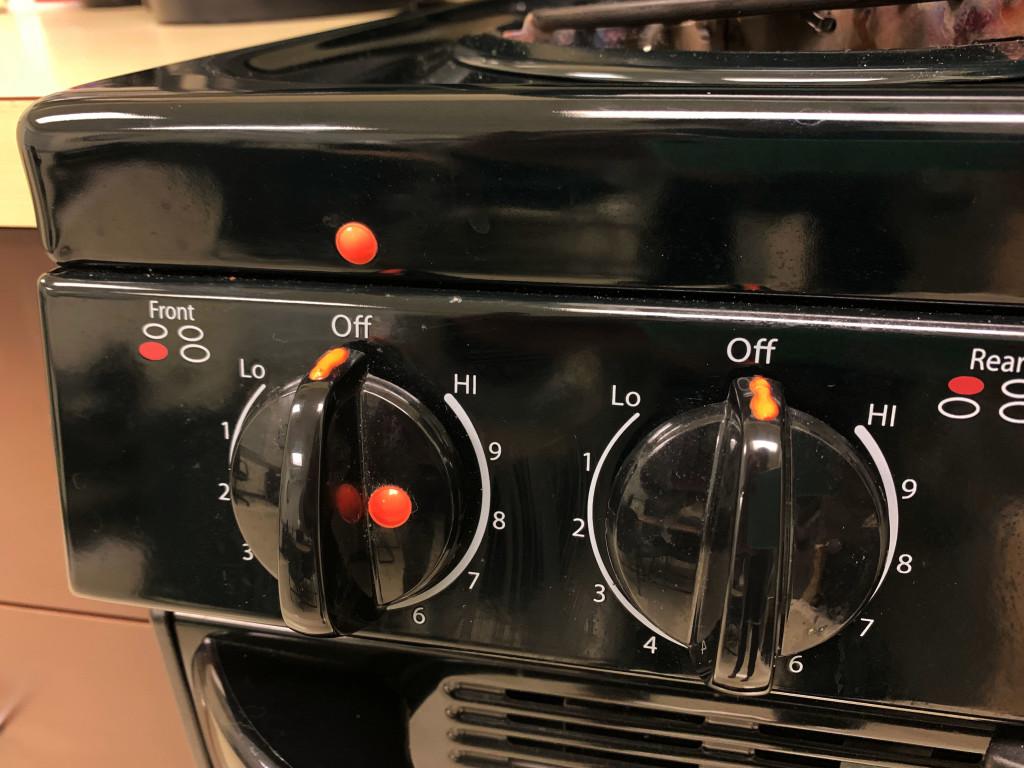 Orange bump dots are shown on a stove