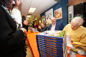 Author Larry Broutman along with Illustrator Rich Green autograph books at the launch of Chicago Treasure
