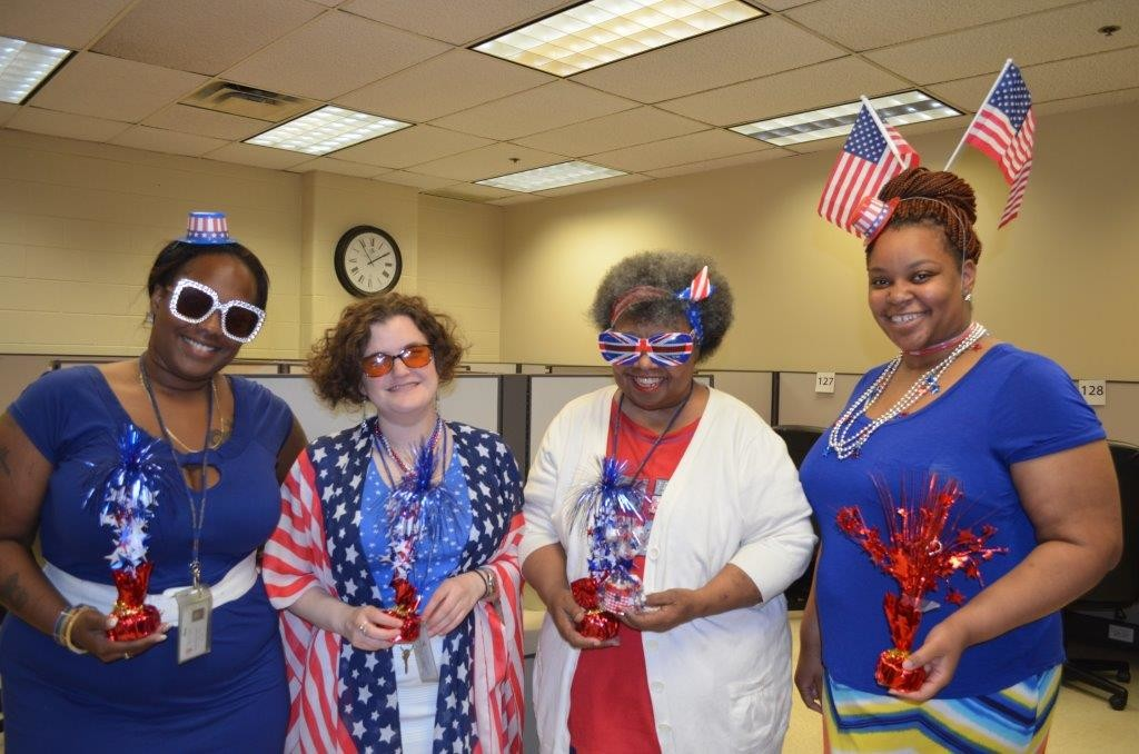 Carly (second left) celebrates Independence Day with her colleagues at The Chicago Lighthouse! Shown left to right are Kameshia Damon of the Advocate Customer Care Center; Carly; Deborah Miles of the Cook County Customer Care Center; and Meredith Hubert of the IDFPR (Illinois Department of Financial and Professional Regulation) Customer Care Center.
