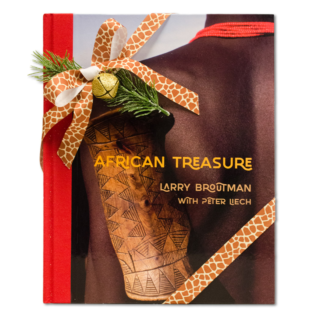 African Treasure book with giraffe print ribbon and bell tied around