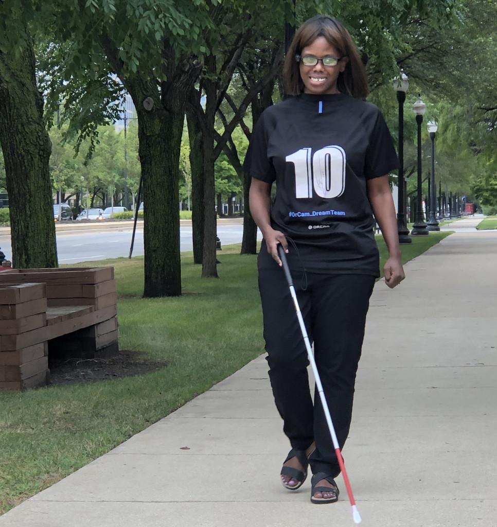 Kalari walking outside using a cane