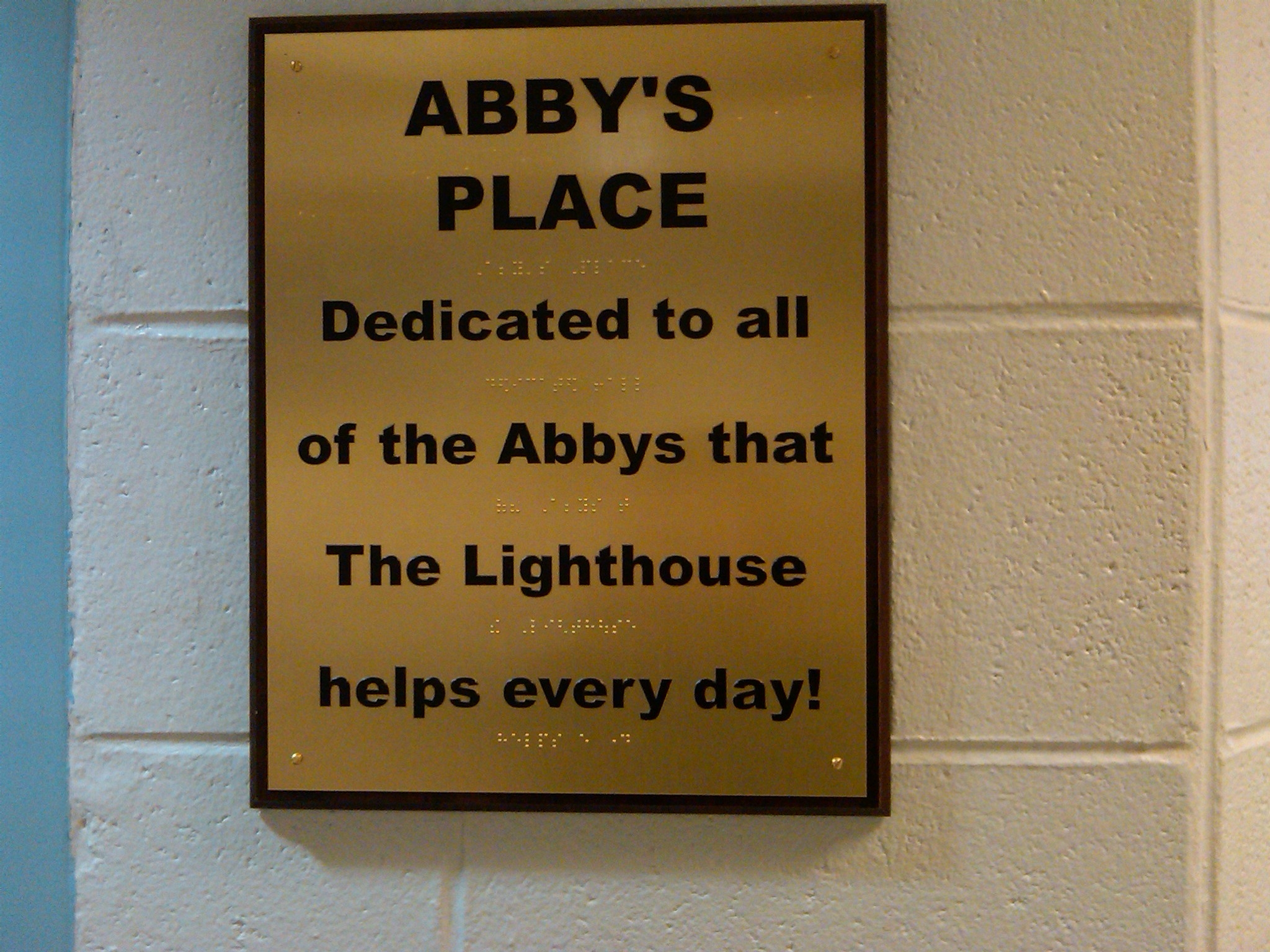 gold plaque that reads: abby's place. Dedicated to all of the Abbys that The Lighthouse helps every day!