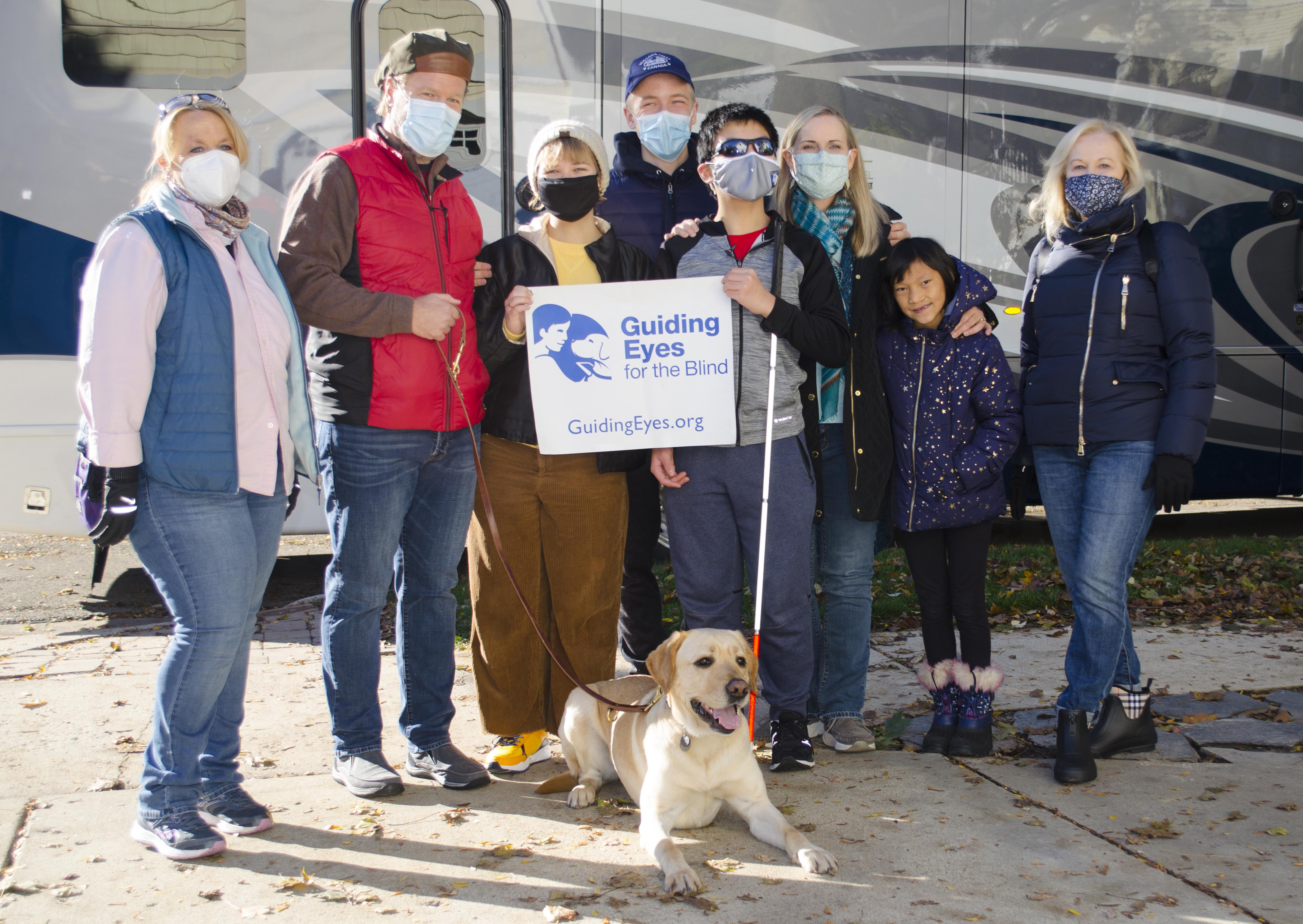 Flyer the dog, with his new family, Woody from Guiding Eyes for the Blind, and Dr. Janet Szlyk from the Chicago Lighthouse