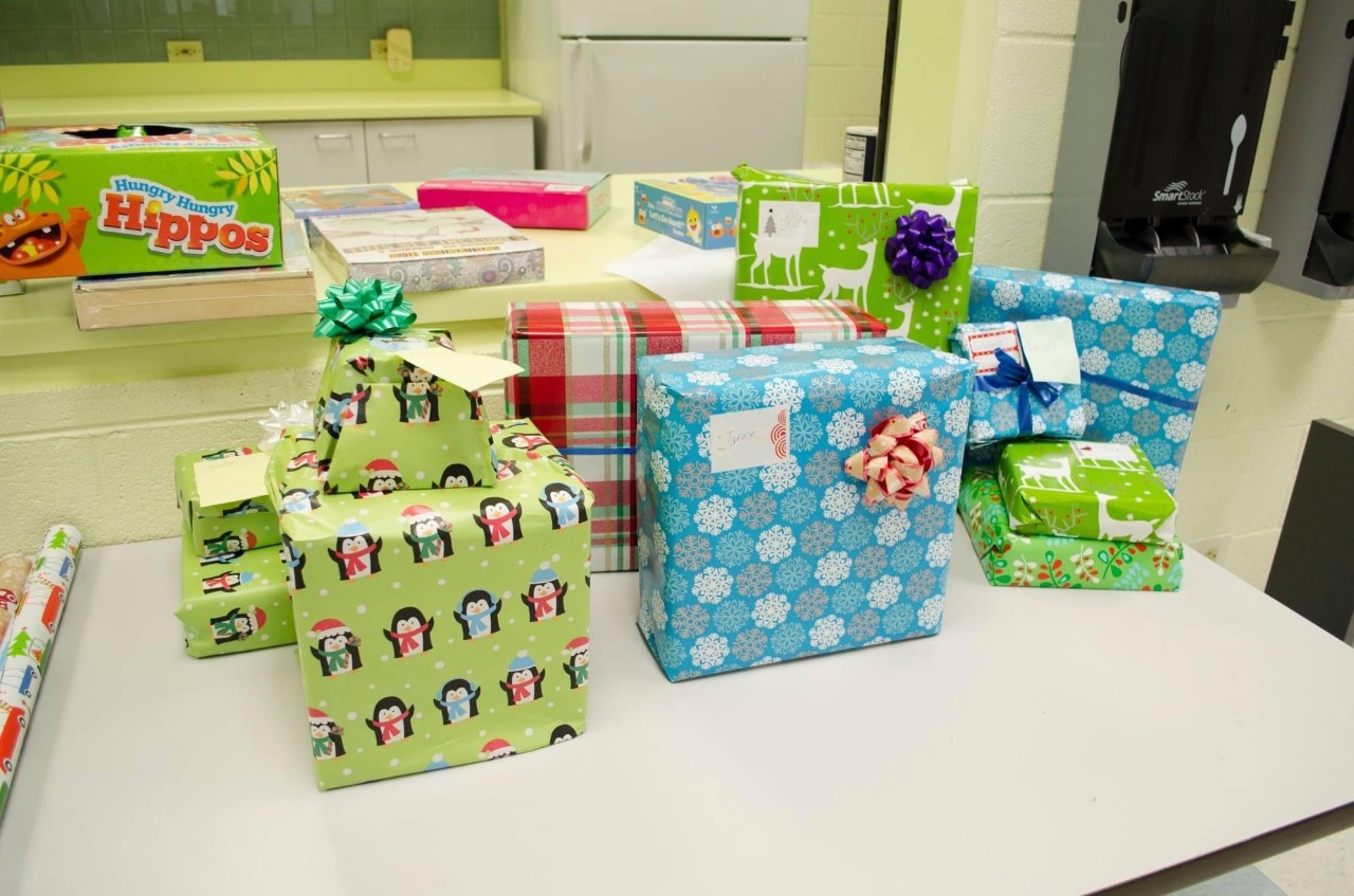 several brightly colored wrapped gifts set on a table