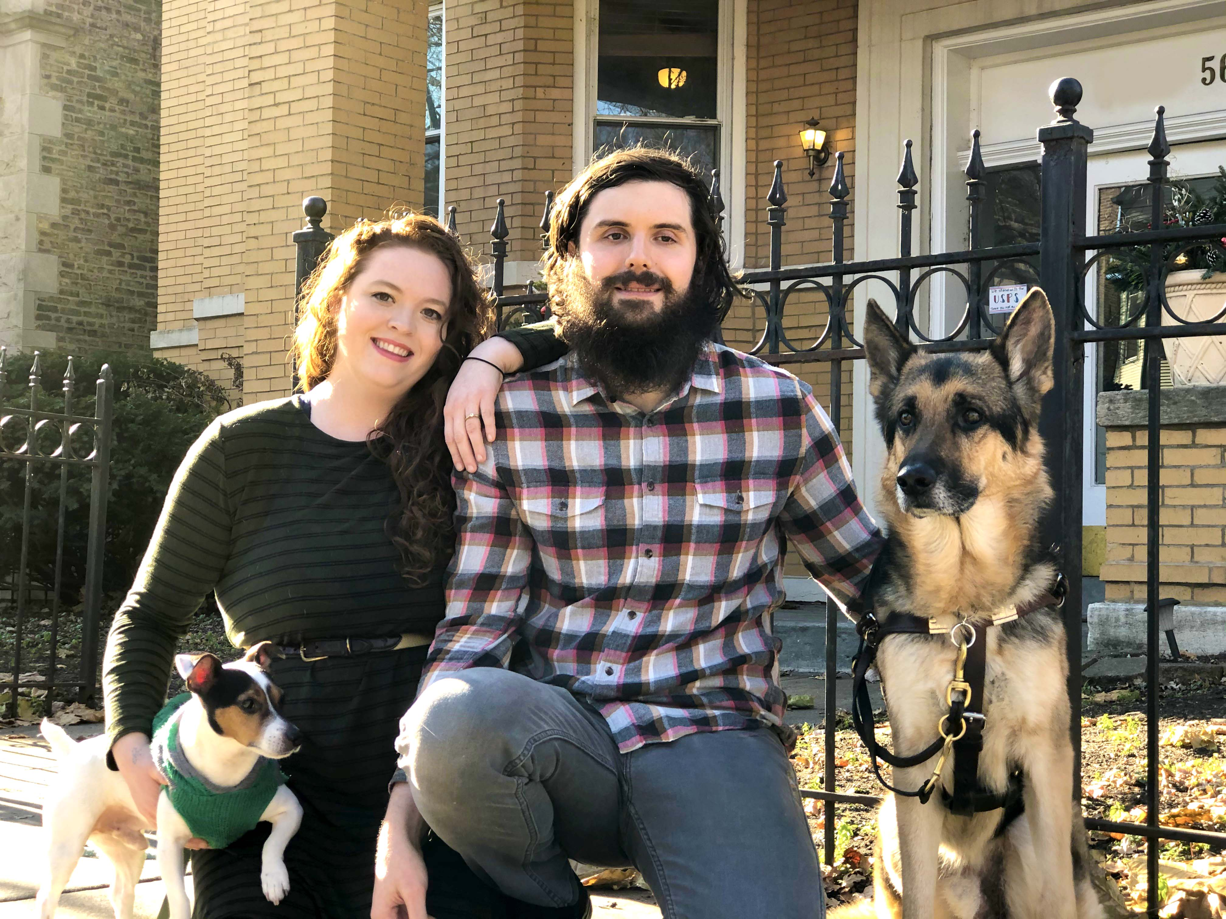 Ben, his wife Martha, and their dogs Louie and Sammie in front of their new home