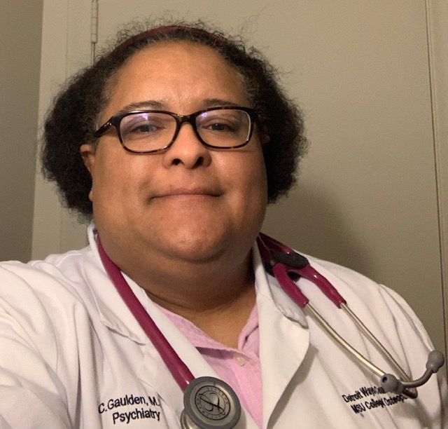Carolyn Gauldent wearing a white coat and stethoscope around her neck