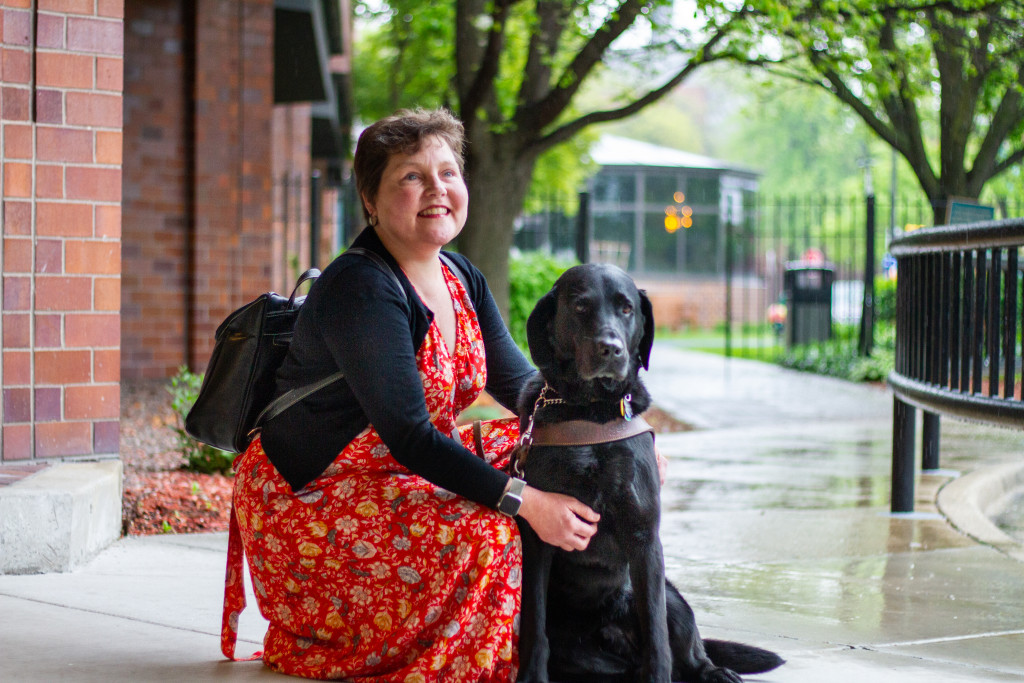 Maureen is pictured alongside her guide dog, Gaston.