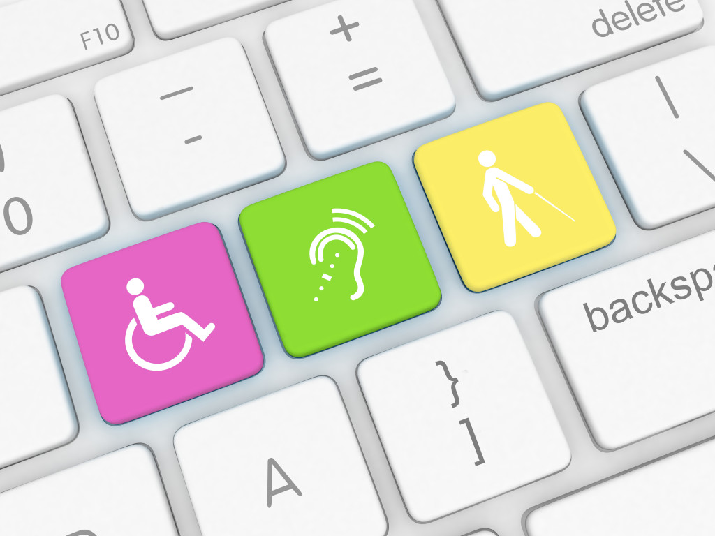 close up graphic of a computer keyboard with three special keys: 1) a wheelchair icon; 2) a hearing icon; 3) an icon of a person with a white cane
